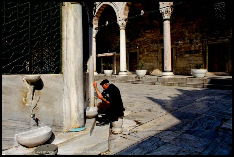 A muslim man is preparing himself for his prayer